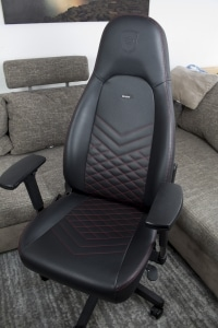 The noblechairs ICON in black imitation leather and red accent seams